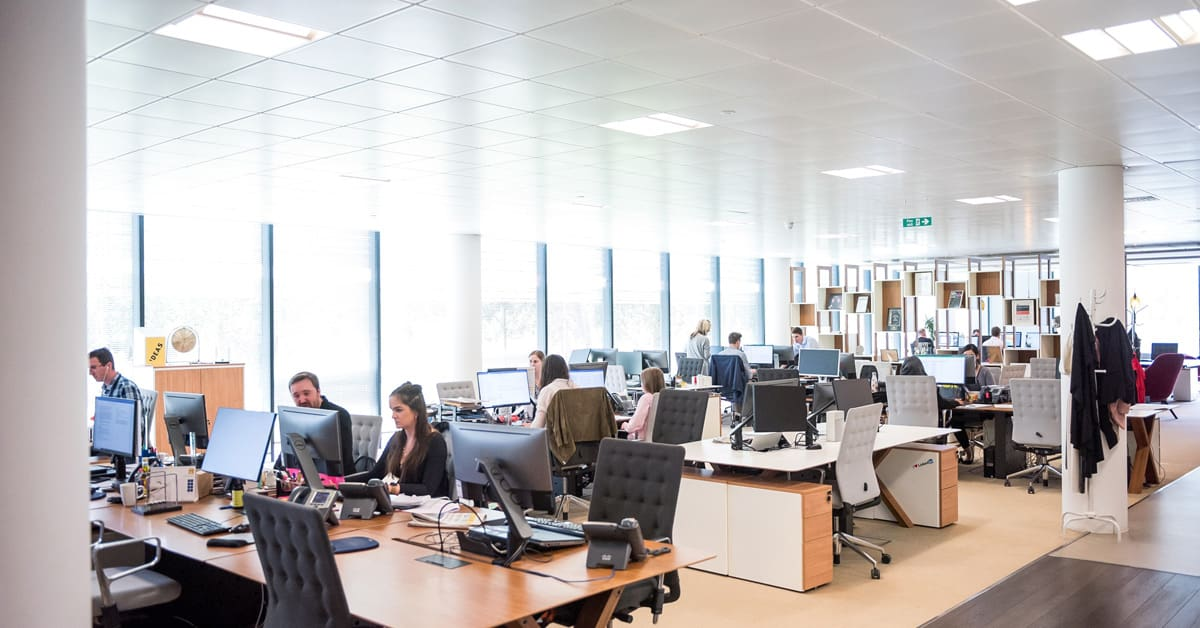 light office space with multiple teams - photo by Arlington Research via Unsplash
